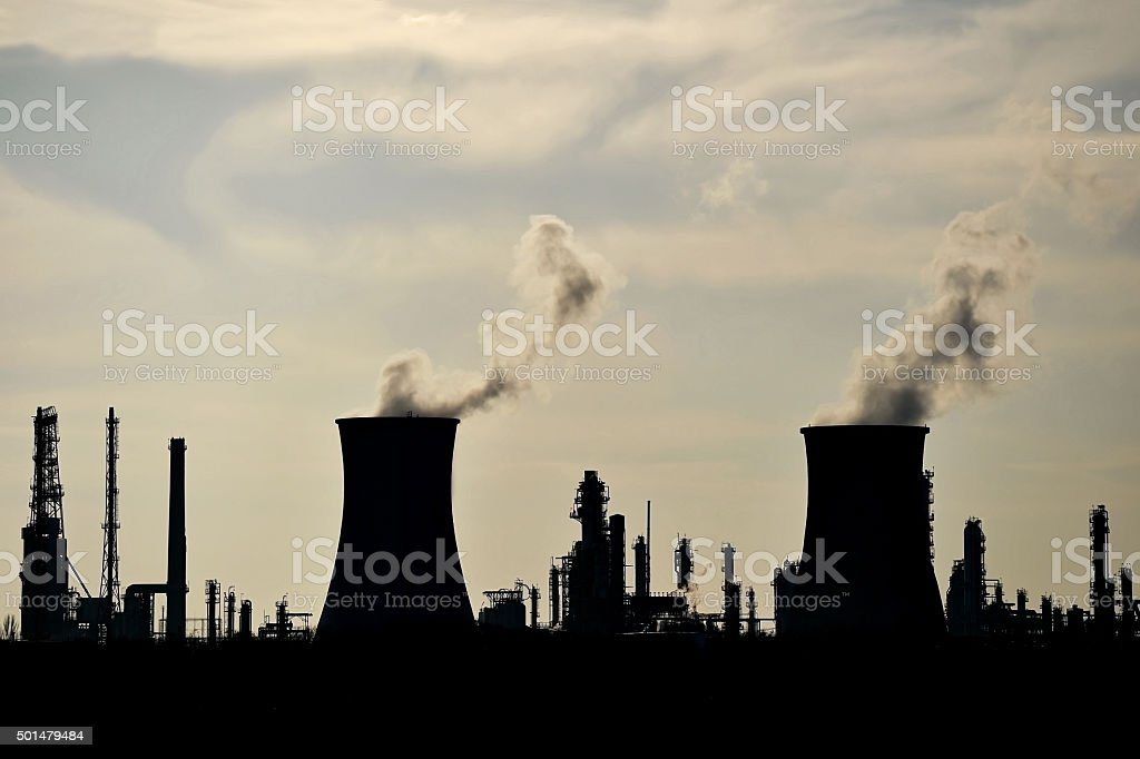 Silhouette of industrial chimneys stock photo