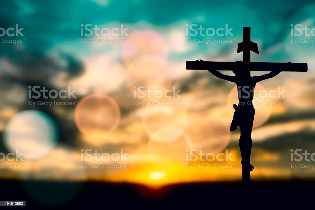 Silhouette of Jesus with Cross over sunset concept for religion,...