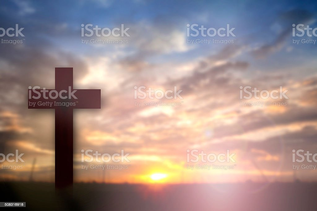 Silhouette of Jesus with Cross over sunset concept for religion, stock photo