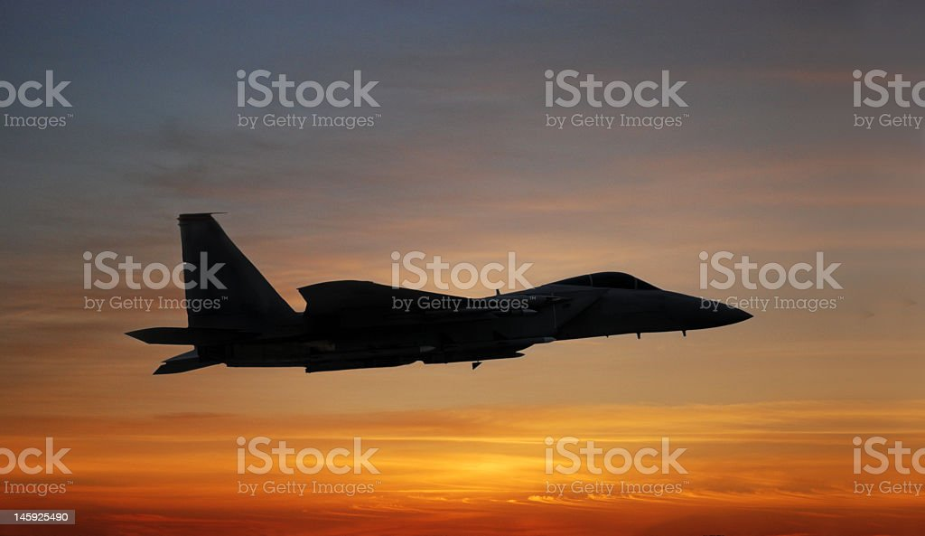 Silhouette of jet profile at sunset royalty-free stock photo