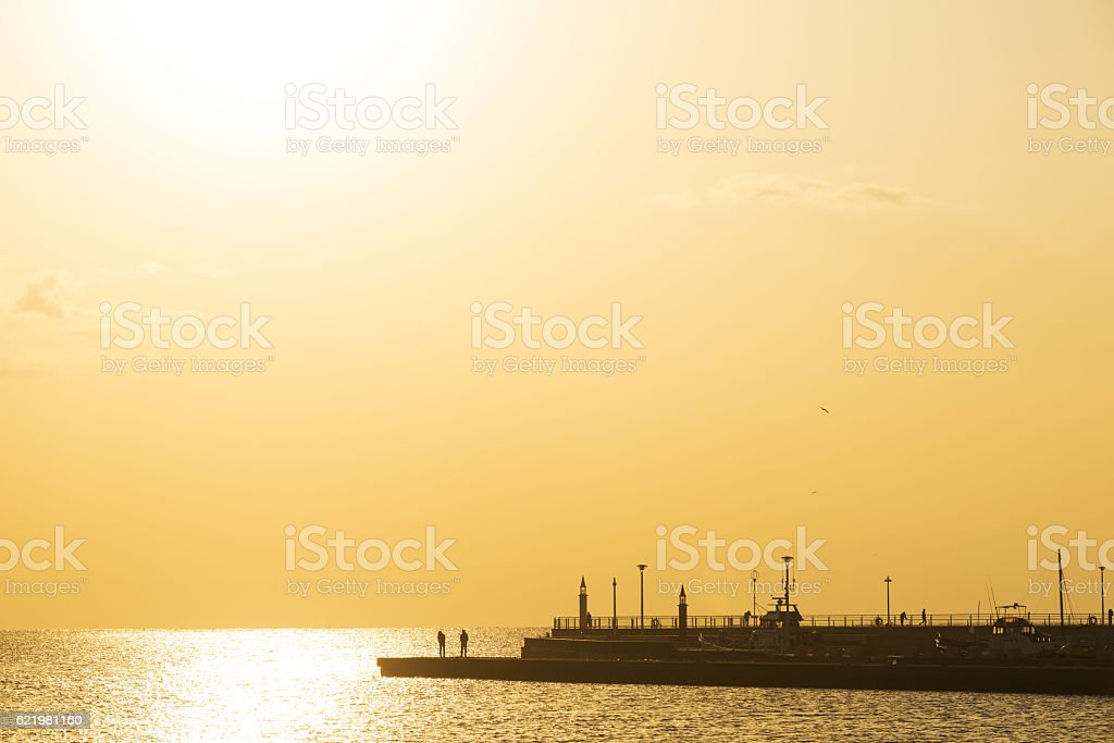 Silhouette of jetties at sunset stock photo