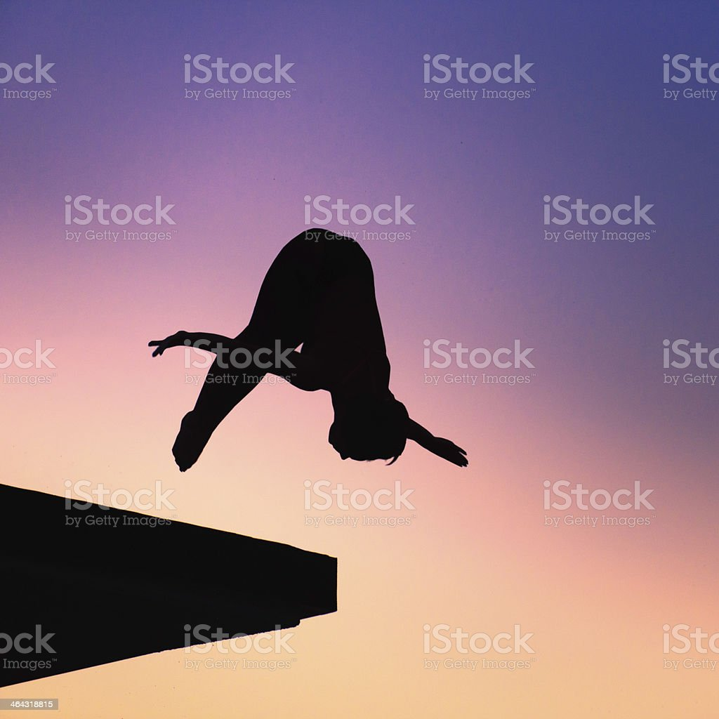 Silhouette of lady diver stock photo