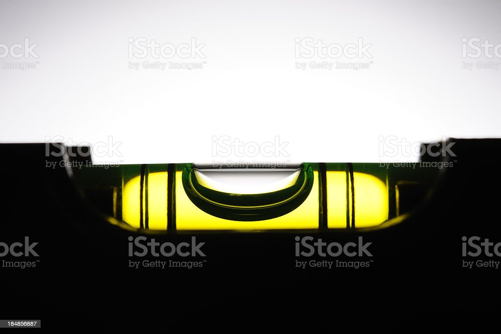 Silhouette of level against white background with copy space stock photo