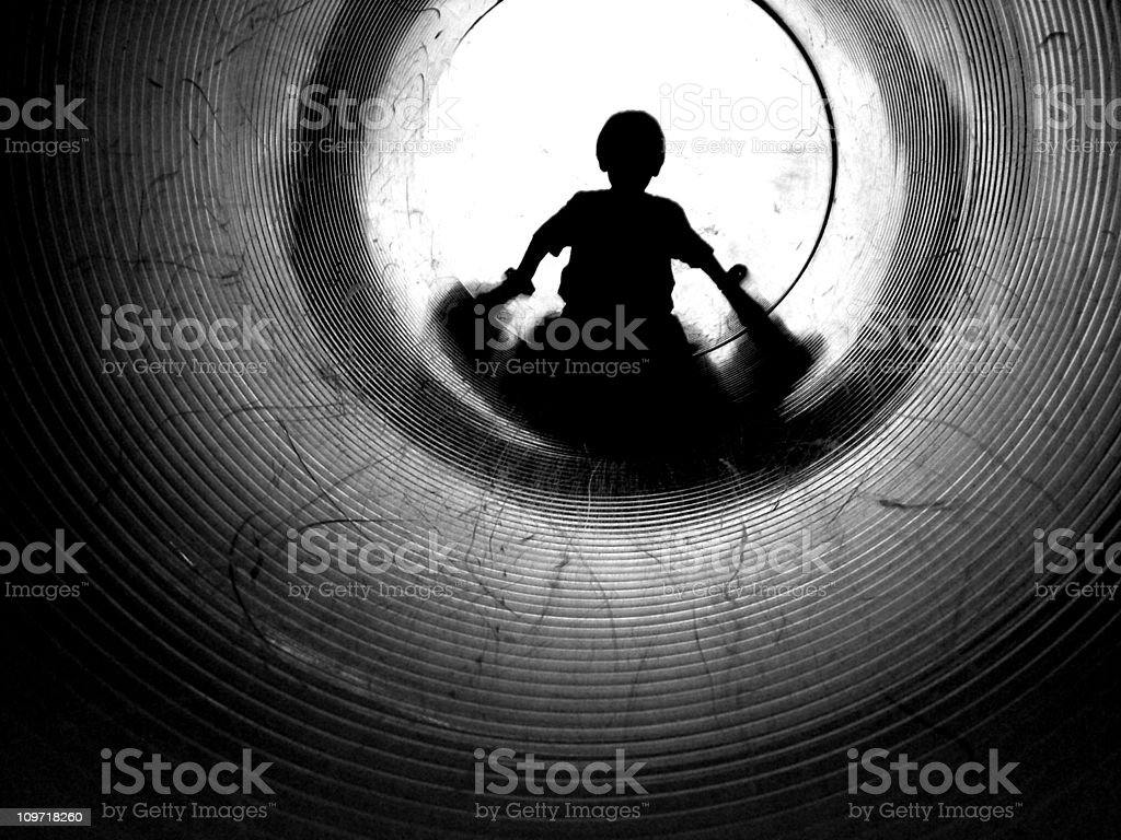 Silhouette of Little Boy Going Down Tunnel, Black and White royalty-free stock photo