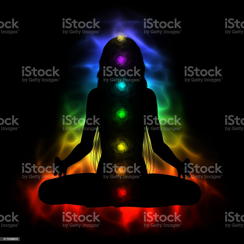 Silhouette of long hair woman meditating - colored chakras stock photo