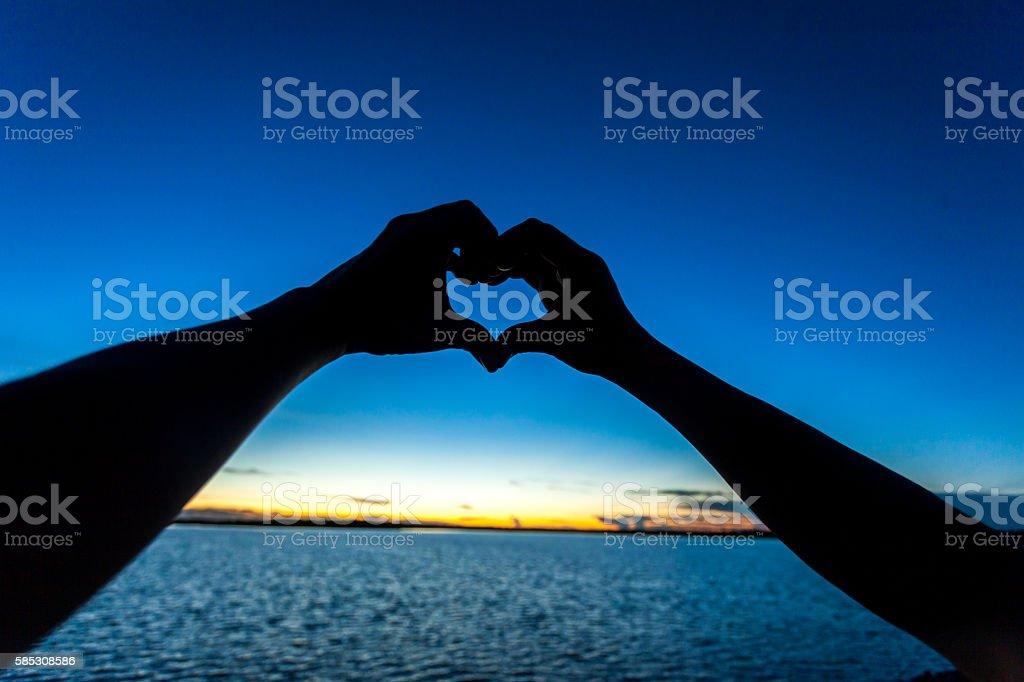 silhouette of love stock photo