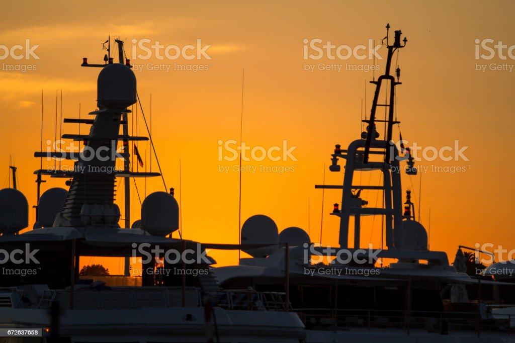 Silhouette of Luxury yachts in Porto Cervo, Sardinia, Italy stock photo