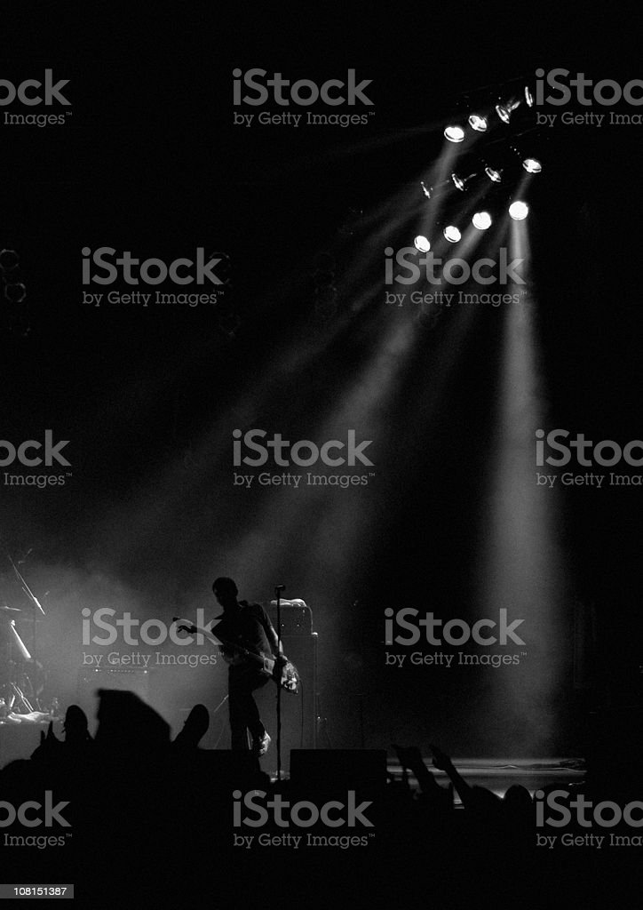 Silhouette of Male Guitariston Stage at Show royalty-free stock photo