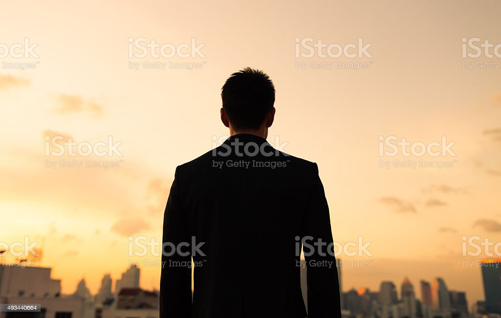 Silhouette of male in the city. stock photo
