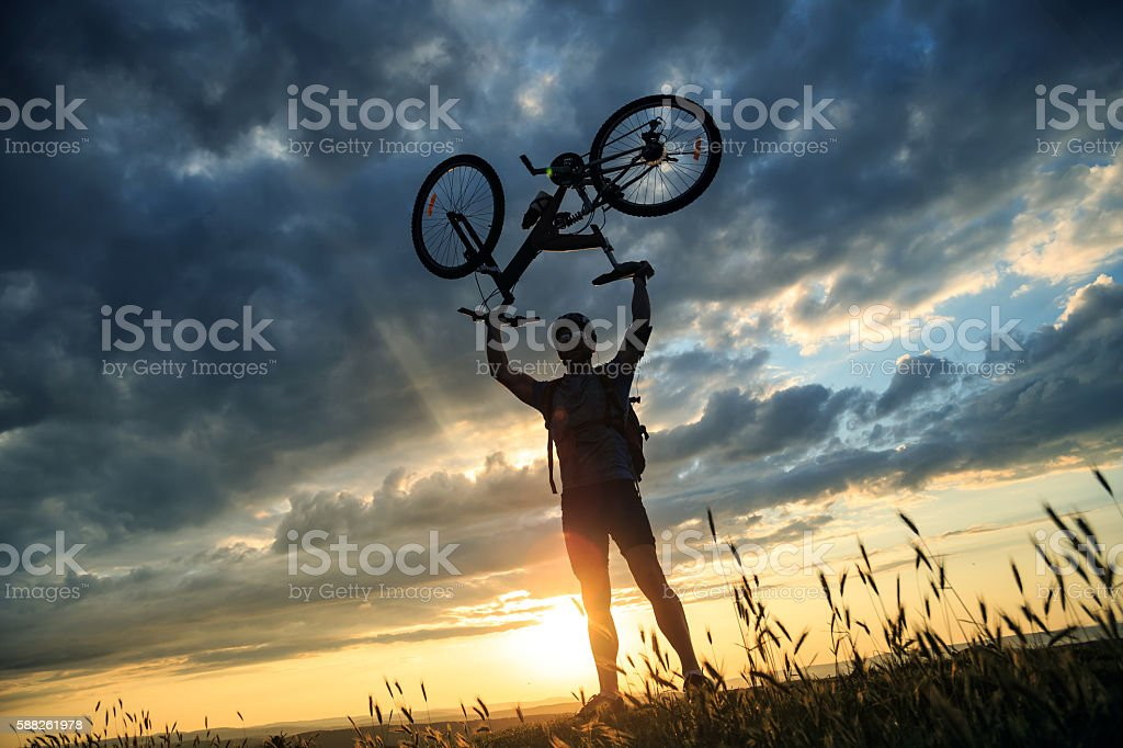 Silhouette of male mountainbiker at the top stock photo