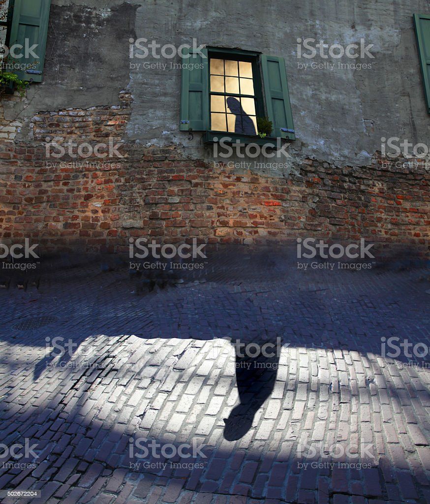 silhouette of man in window stock photo