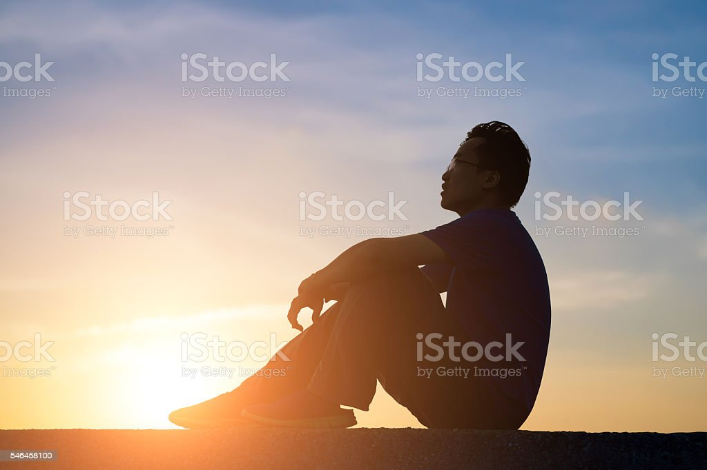 Silhouette of  man is looking stock photo