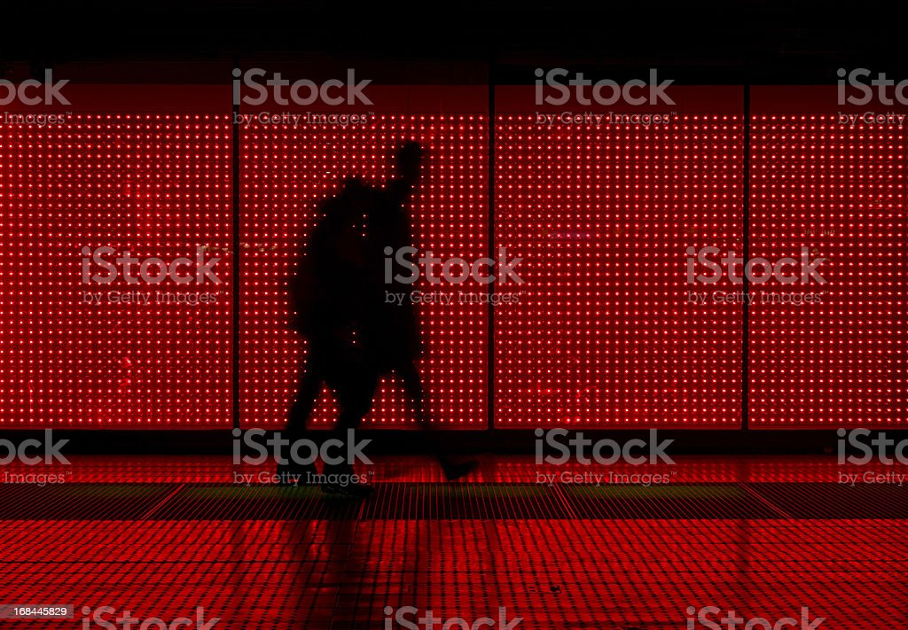 Silhouette of man moving in red background royalty-free stock photo