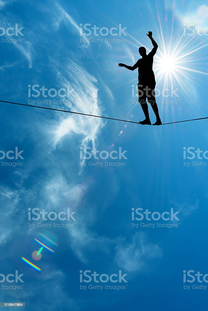 Silhouette of man on the rope stock photo