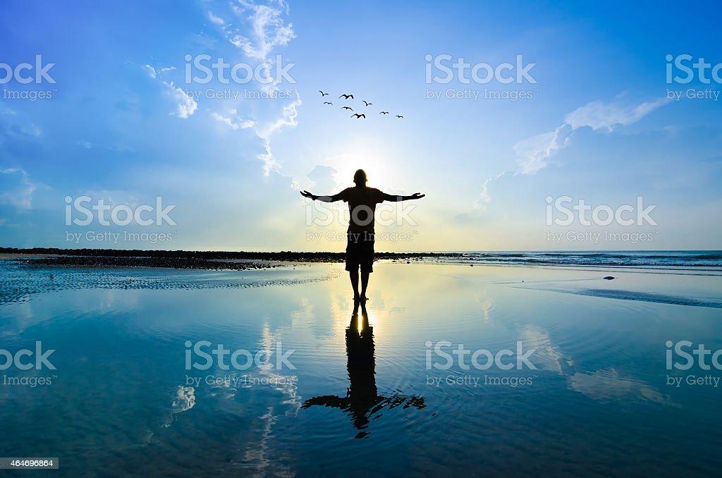 Silhouette of Man Raising His Hands stock photo