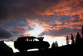 Silhouette of Man Relaxing by SUV in the Mountains