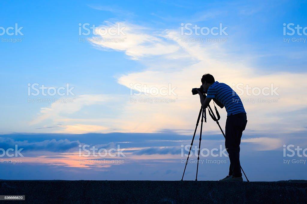 Silhouette of man shot camera stock photo