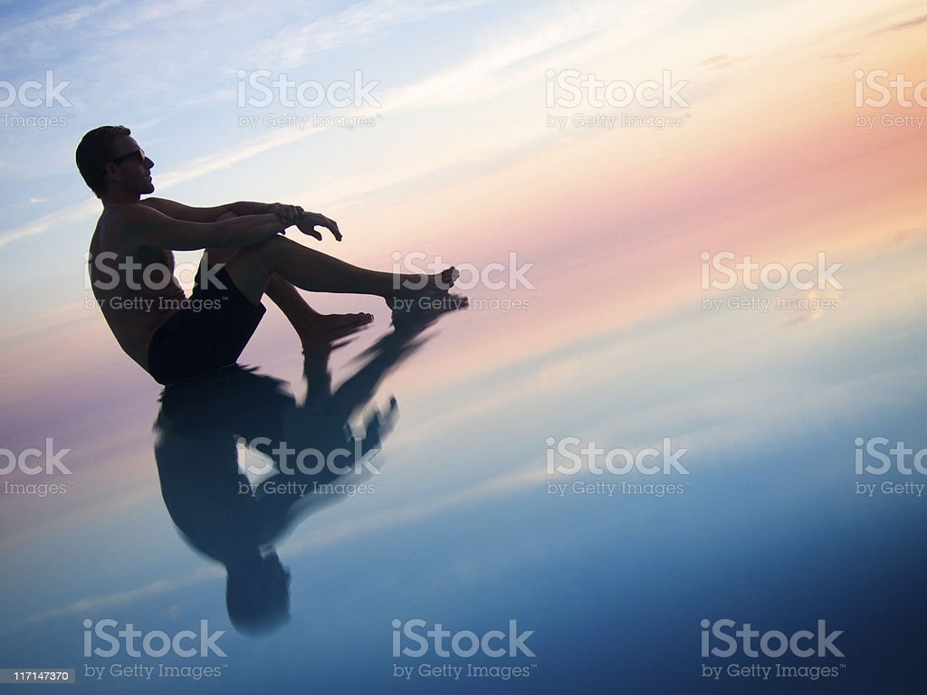 Silhouette of Man Sitting in Sunrise Sunset Sky Infinity Pool royalty-free stock photo