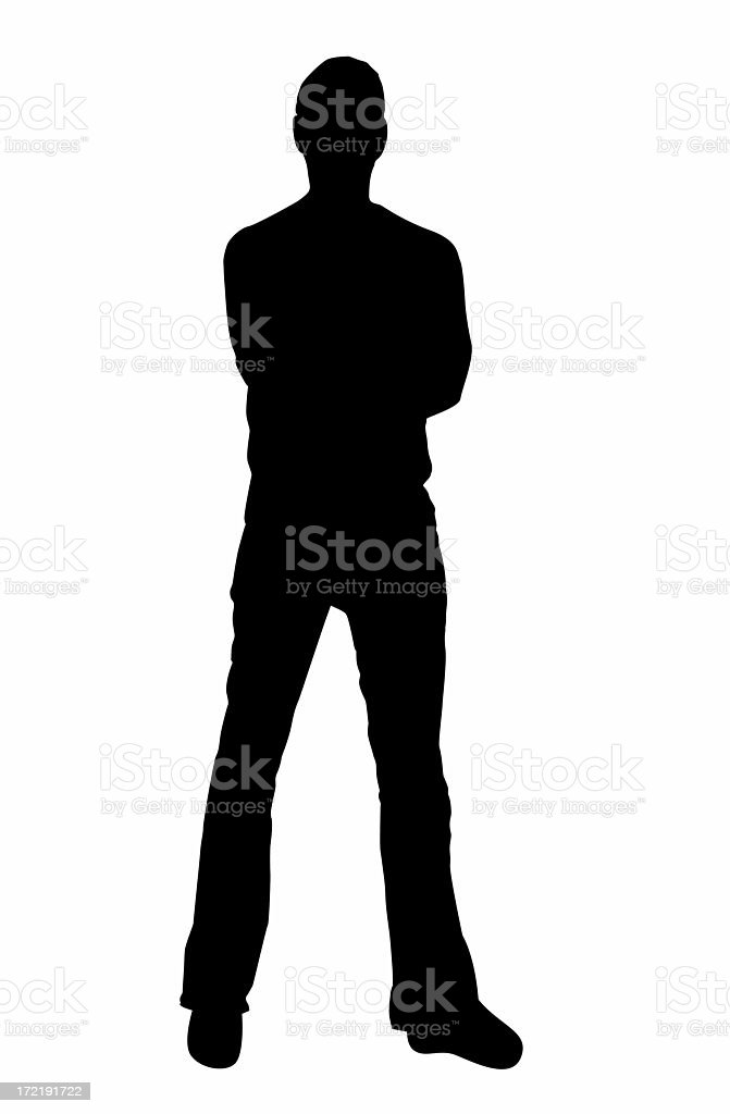 Silhouette of man standing confidently stock photo