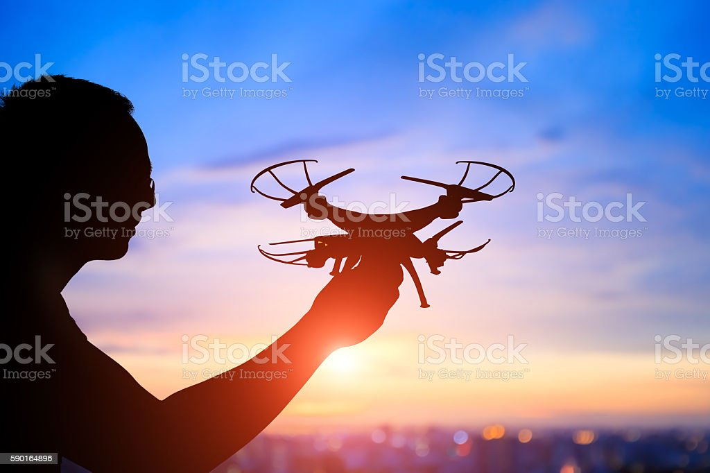 silhouette of man take drone stock photo