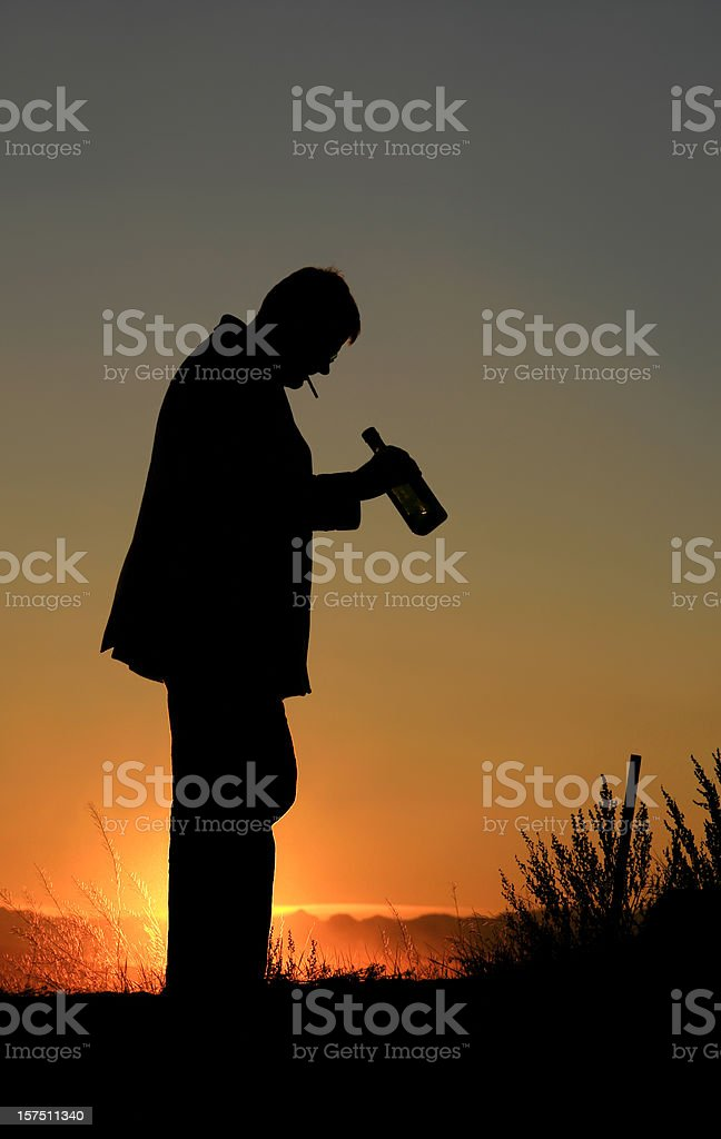 Silhouette of Man With Alcoholism and Addiction stock photo