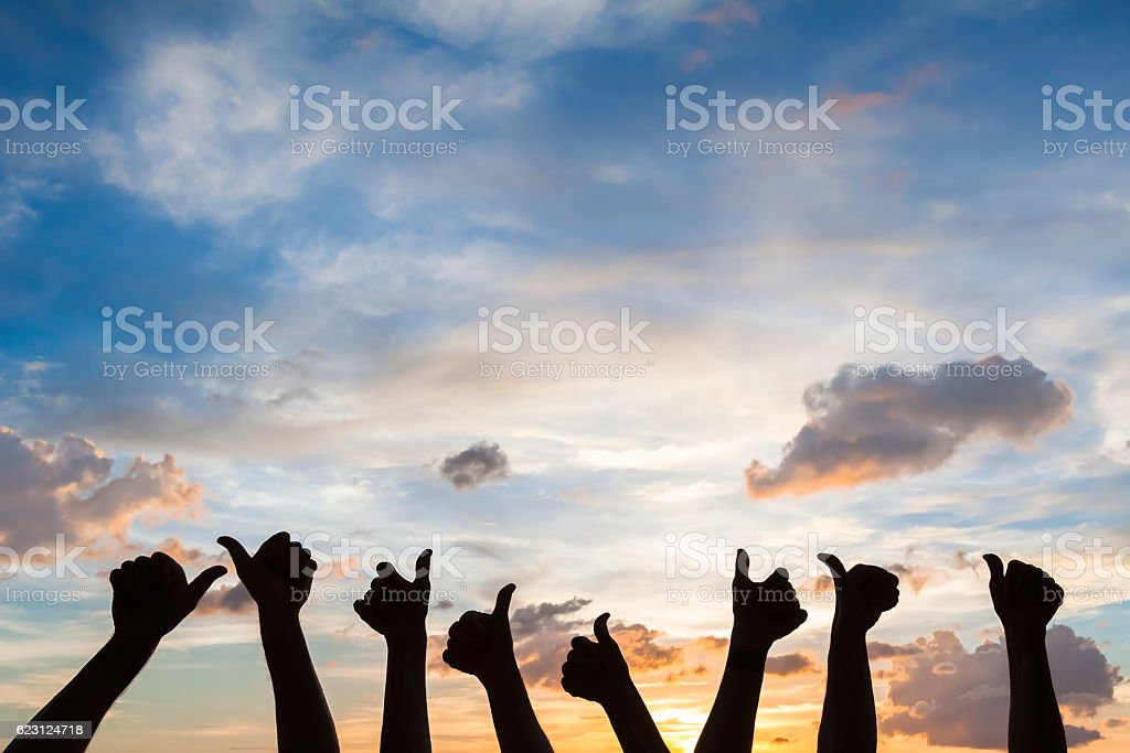 Silhouette of many thumbs up, like symbol, satisfaction, agreement stock photo