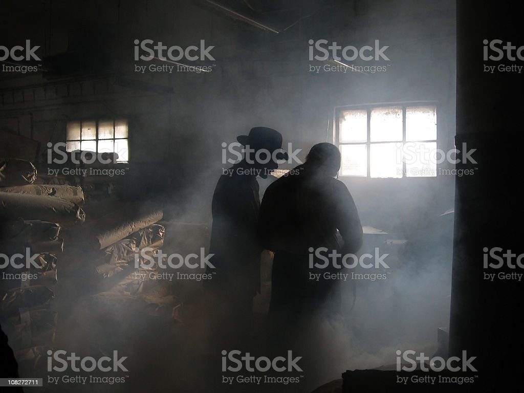 Silhouette of Men in Smoke stock photo