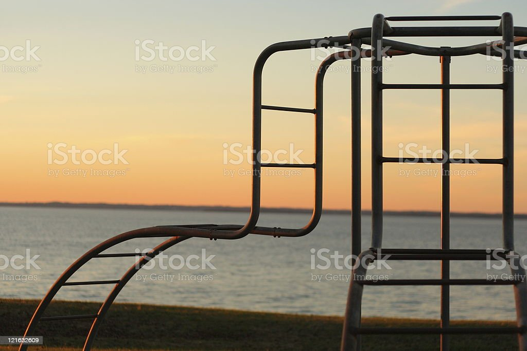 Silhouette of monkey bars stock photo