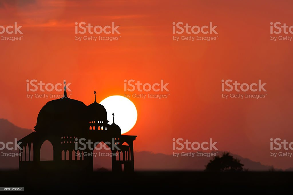 Silhouette of Mosque sunset background stock photo