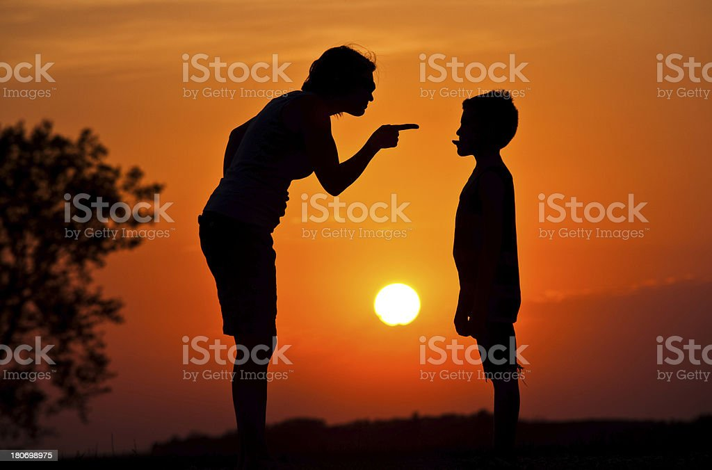 Silhouette of Mother Scolding A Disrespectful Child stock photo