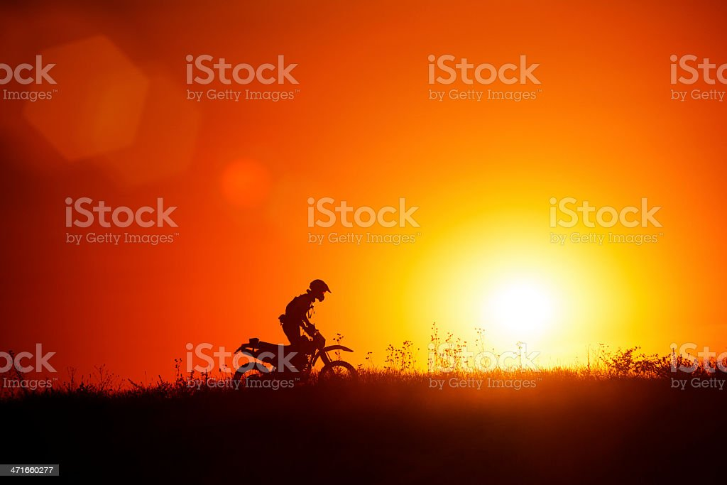 Silhouette of motocross rider royalty-free stock photo