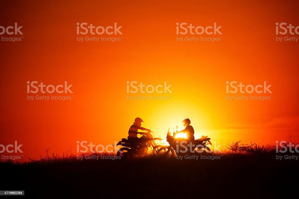 Silhouette of motocross riders royalty-free stock photo