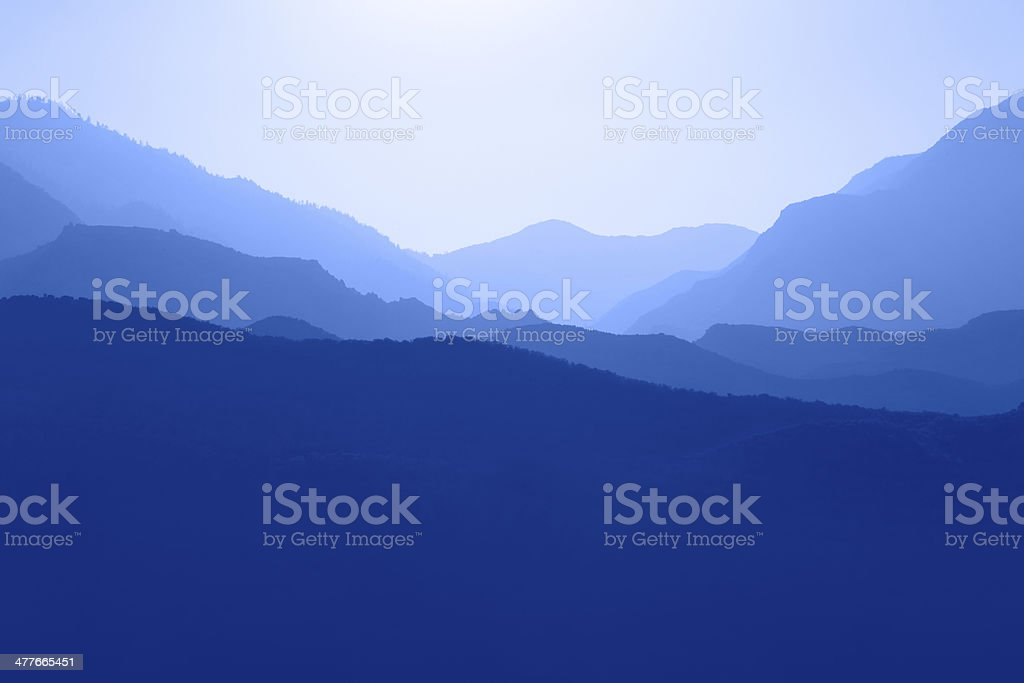 Silhouette of Mountain Range Layered in Blue royalty-free stock photo