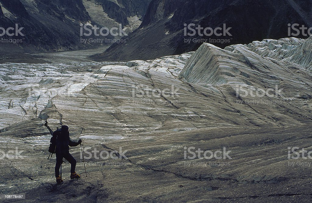 Silhouette of Mountaineer Standing on Mount Blanc Mountain royalty-free stock photo