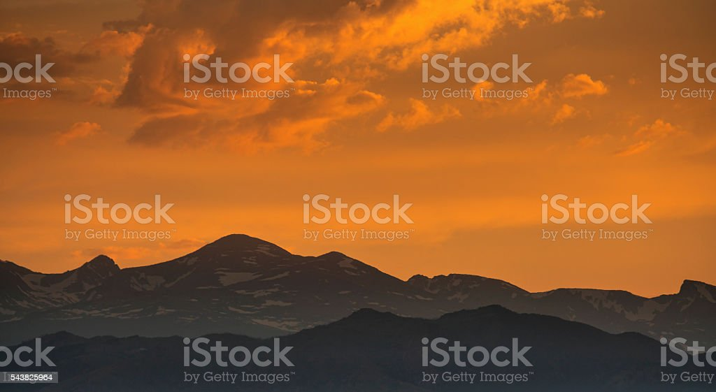 silhouette of mountains against sunset sky stock photo