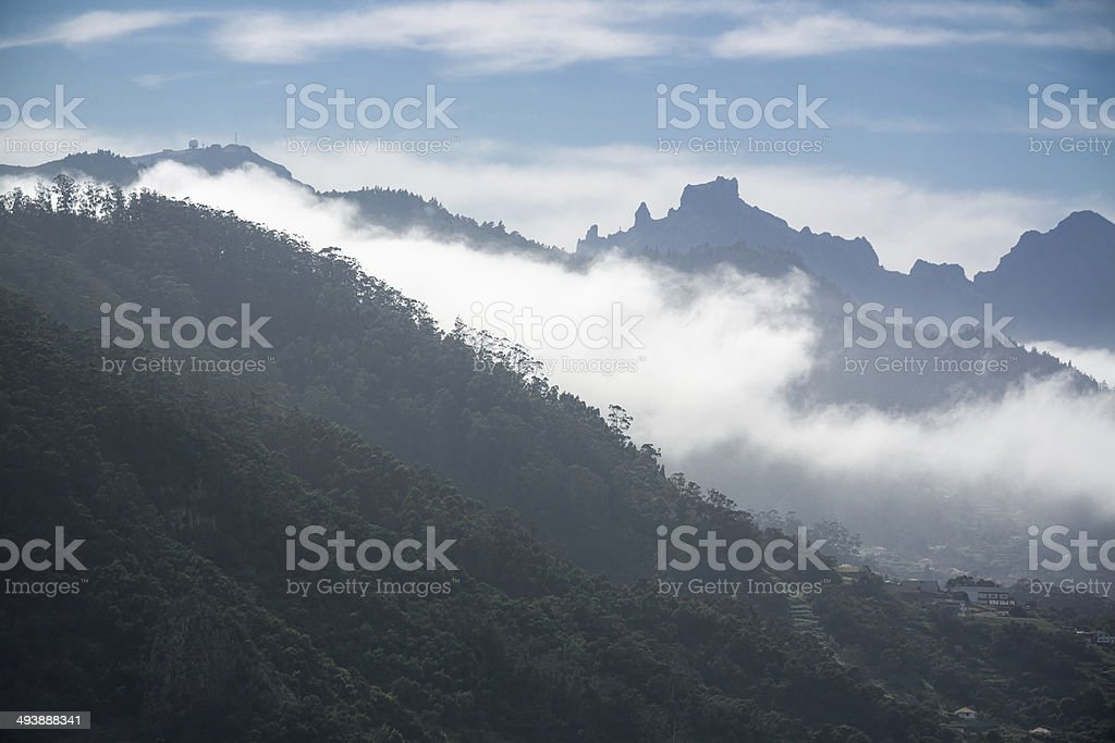 Silhouette of mountains with clouds at Madeira Island, Portugal stock photo