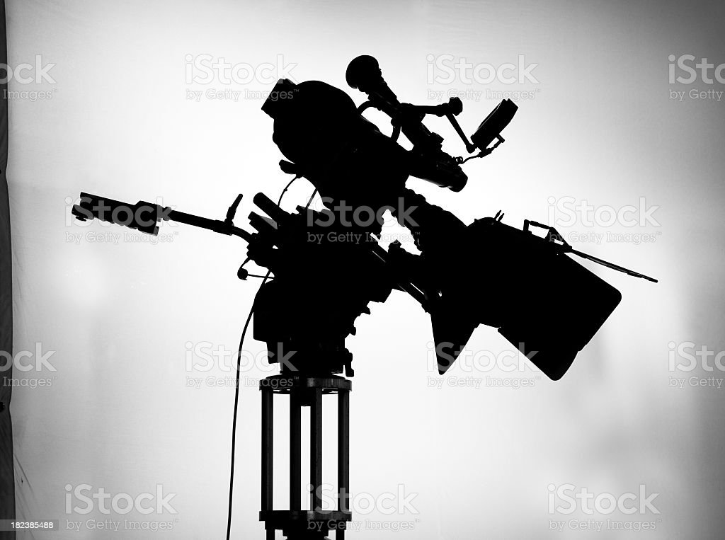 silhouette of movie camera on set royalty-free stock photo
