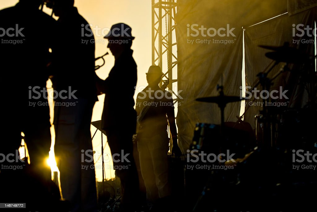 Silhouette of musicians at the stage stock photo