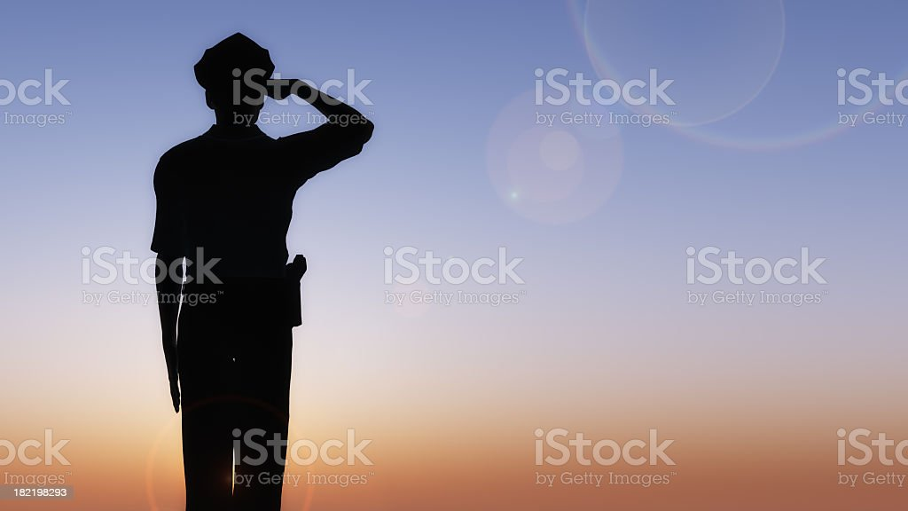 Silhouette of officer saluting in the sunset stock photo