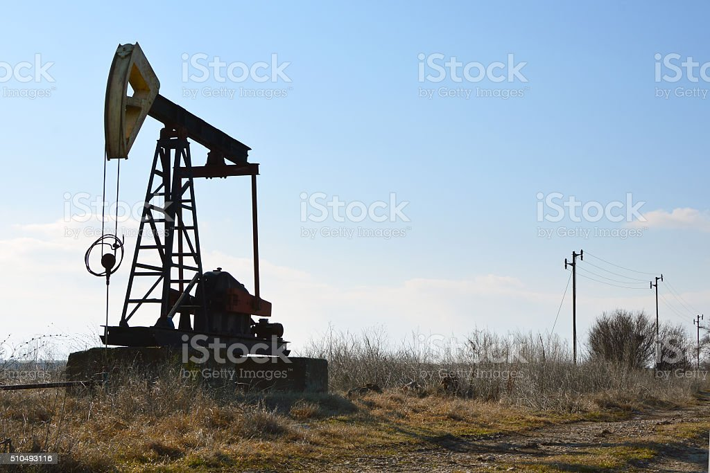 Silhouette of Oil Pump in the fields near Sabla, Bulgaria stock photo