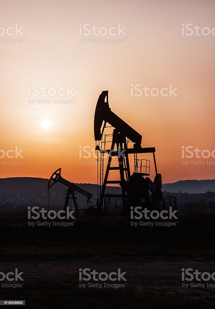 silhouette of oil pump stock photo