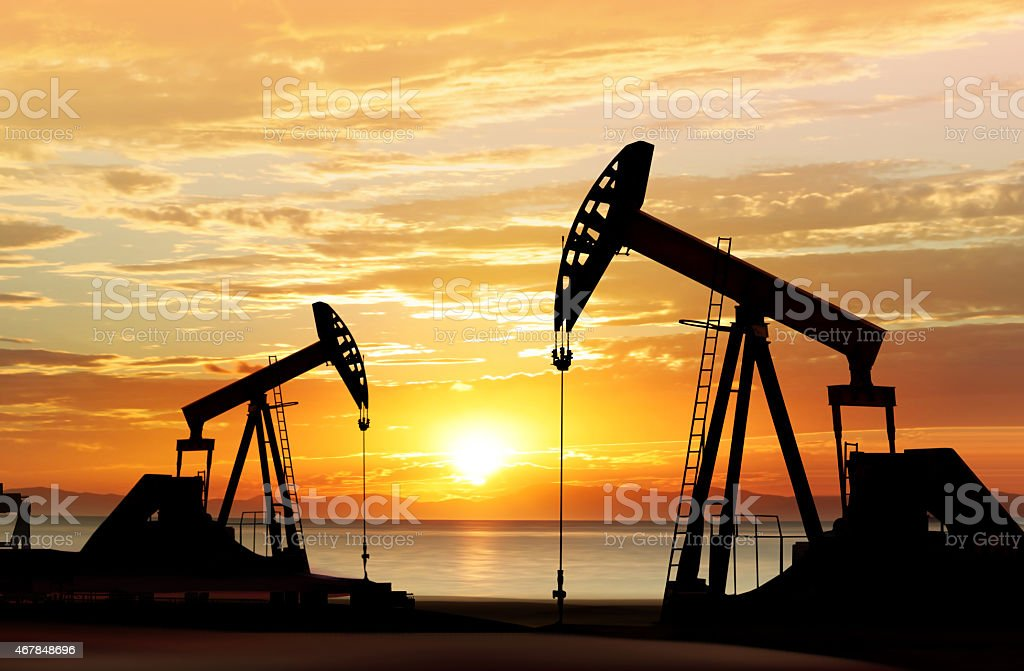 silhouette of oil pumps stock photo