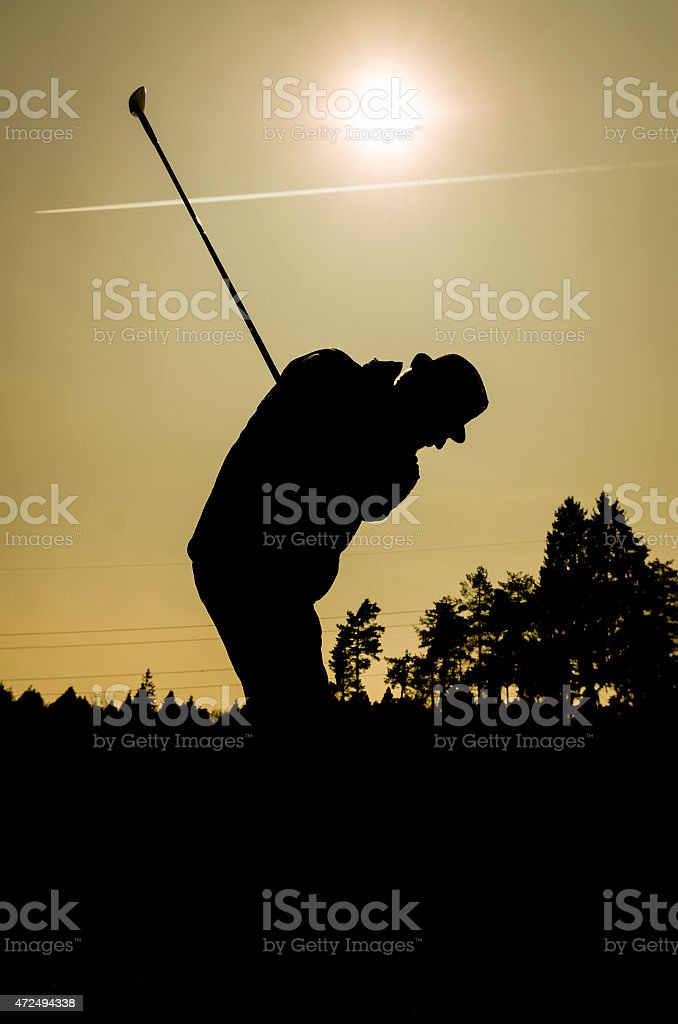Silhouette of old man playing golf. Senior citizen stock photo