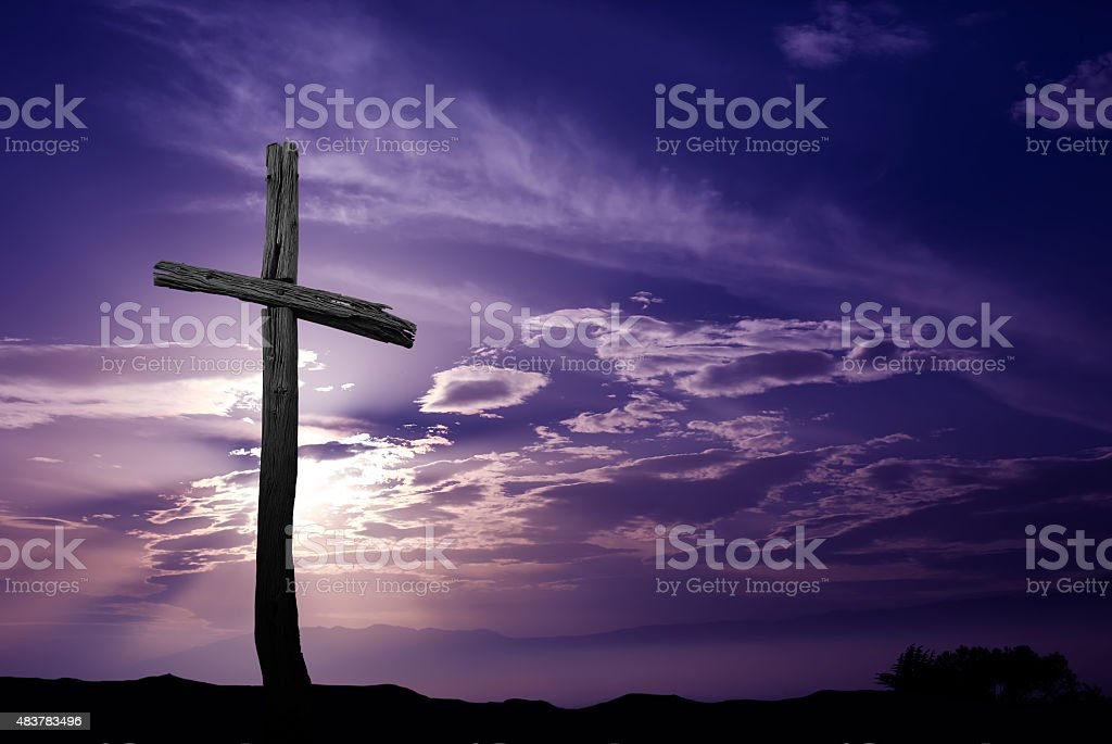 Silhouette of Old WoodenCross at Sunrise stock photo