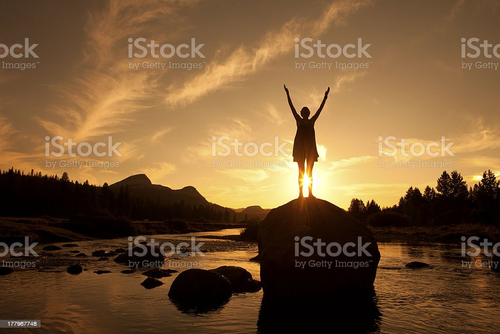 Silhouette of Outdoor Yoga, Sun Salutation stock photo
