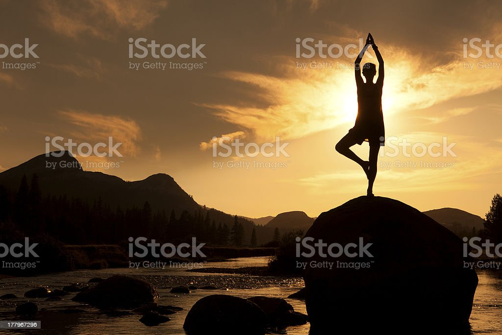 Silhouette of Outdoor Yoga, Tree Pose stock photo