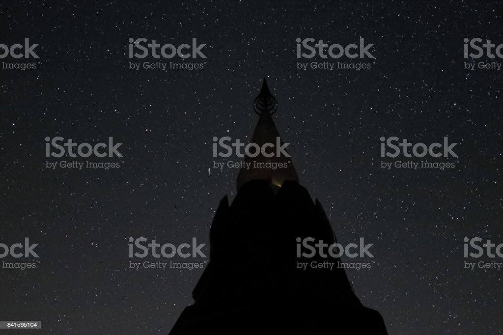 Silhouette of pagoda  buddhism against night sky with stars stock photo