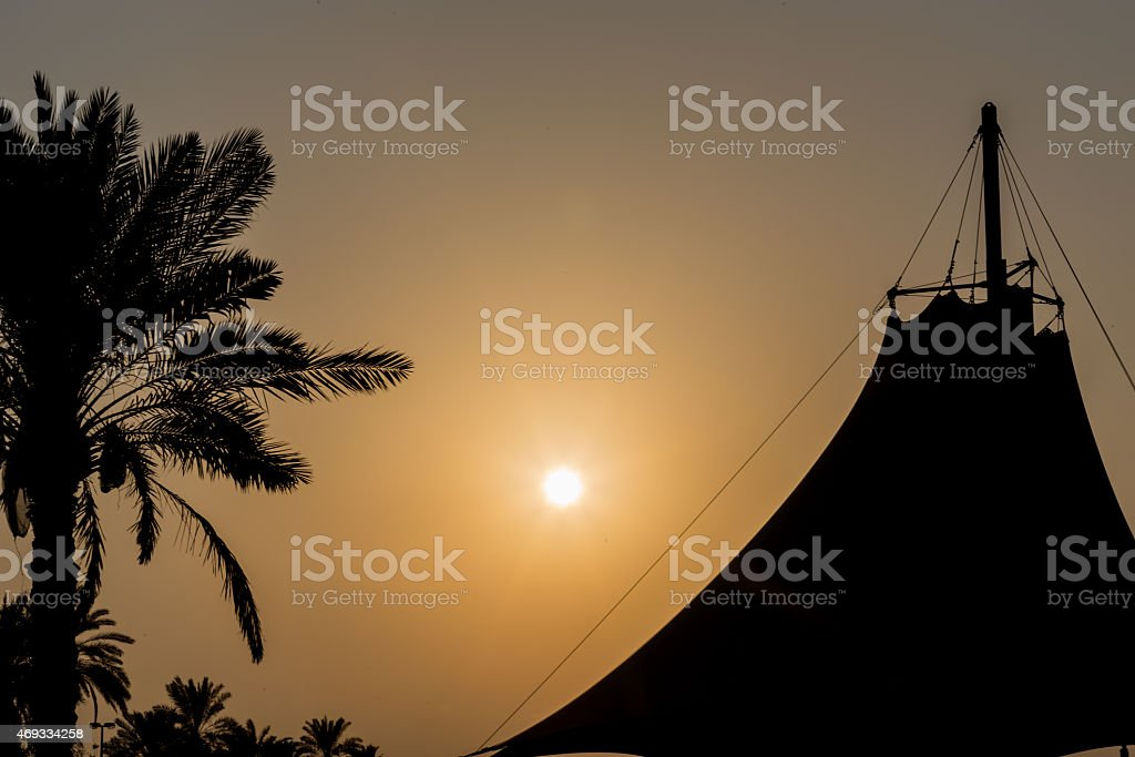 Silhouette of Palm Tree and Arabian Style tent stock photo