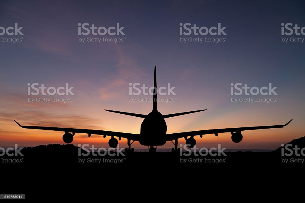 Silhouette of  passenger aircraft, airline on beautiful sunset stock photo