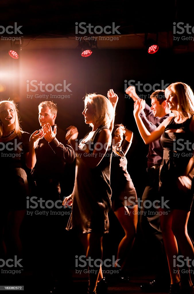 Silhouette of people dancing in nightclub royalty-free stock photo